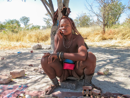 ETOSHA, NAMIBIA - JULY 12, 2014: Unidentified woman from Himba tribe in Etosha National park in Namibia. Himba tribe the last remaining tribe in Namibia.