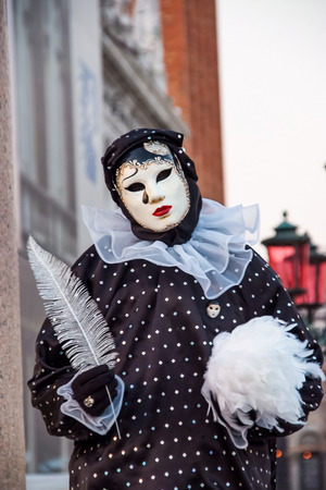 1 person: VENICE, ITALY - FEBRUARY 1, 2008: Unidentified person with Venetian carnival mask in Venice, Italy. At 2008 it is held from January 26th to February 5th.