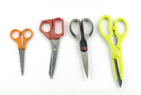 used Scissors isolated with white background photo
