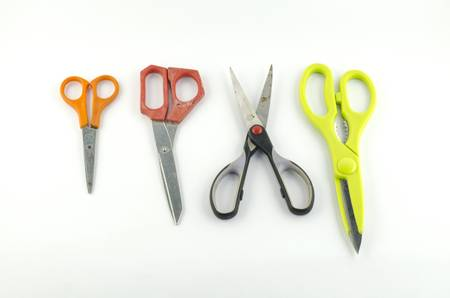 four used Scissors isolated with white background photo