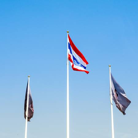waft: Thai flag with two another flag and bule sky background