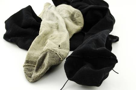 used dirty sock isolated on white background photo