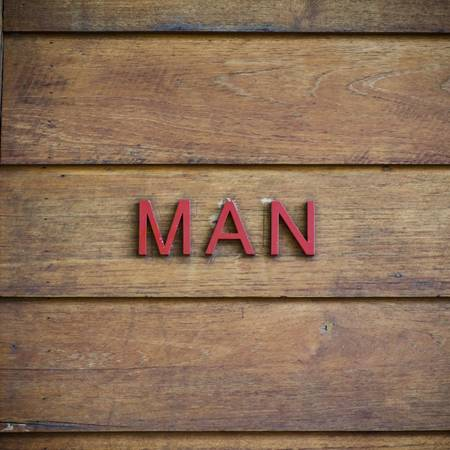 word art: man toilet symbolic on wood background texture Stock Photo
