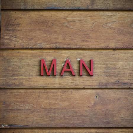 man toilet symbolic on wood background texture Stock Photo - 20041205