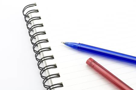 blue and red pen with notebook isolated on white background photo