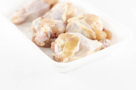 food fresh chicken in foam isolated on white background photo