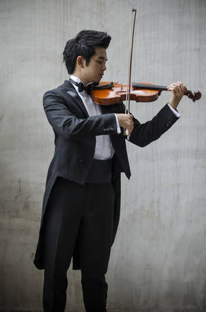 soloist: Thailand asia man with his violin he is a soloist Stock Photo