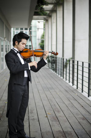 Thailand asia man with his violin he is a soloist Stock Photo
