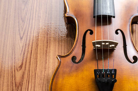 string instrument violin on wood background Stock Photo