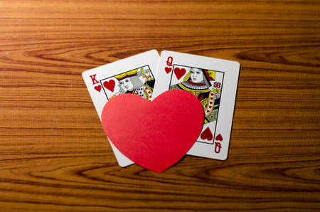 king and queen: heart and love king queen  card on wood background Editorial