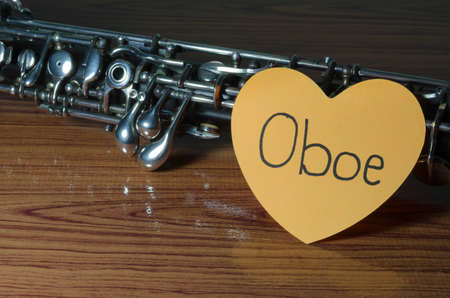 oboe with heart n wood background photo