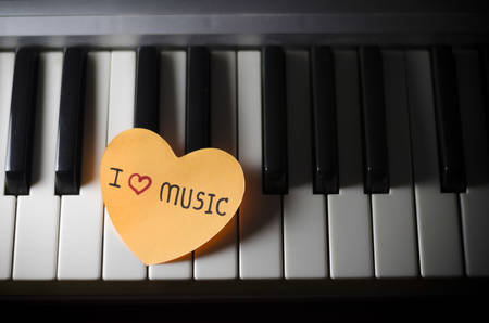 heart on key piano say love music