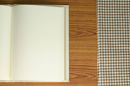 notebook with kitchen towel on wood background Stock Photo