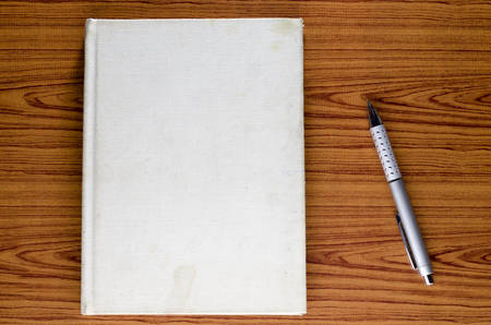 notebook on wood background photo