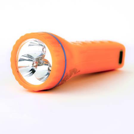 used orange flashlight isolated on white background Stock Photo