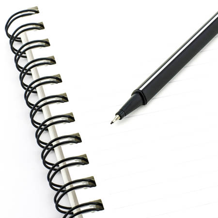 black pen with notebook isolated on white background photo