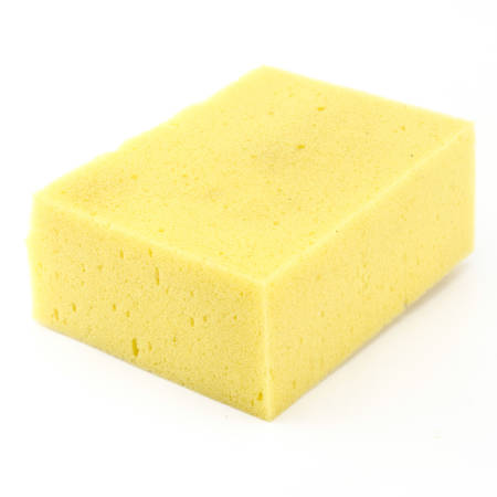 yellow household sponge isolated on white background photo