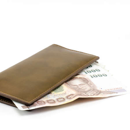 thai banknote in brown wallet isolated on white background Stock Photo