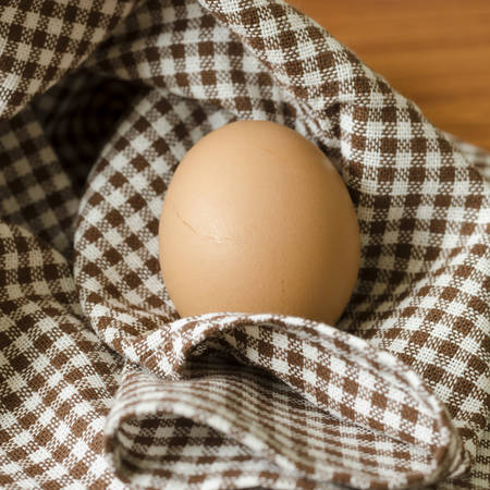 egg in kitchen towel on table