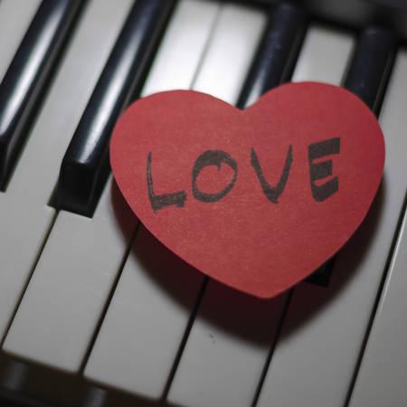 heart on key piano say love music