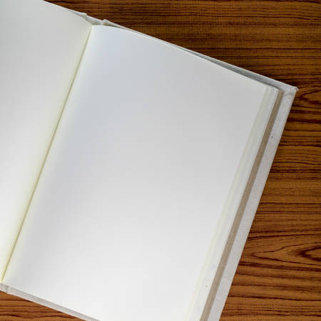 notebook on wood background Stock Photo