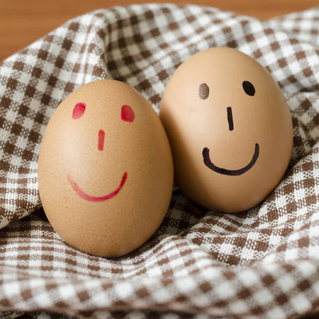 smile love egg couple in brown kitchen towel on wood table photo