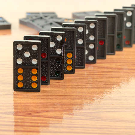 black domino on wooden background