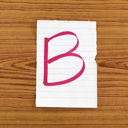 grade b on wood wall background Stock Photo