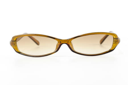 brown sunglasses isolated on white background photo
