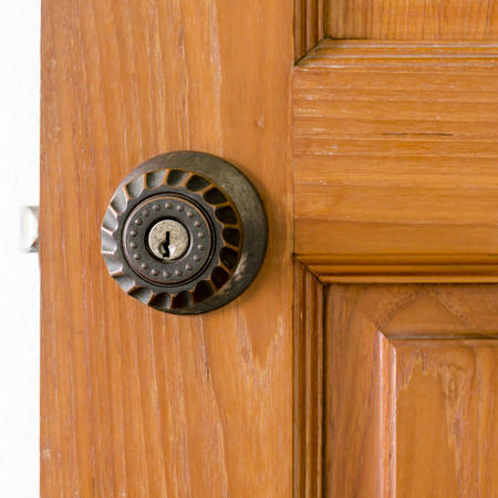 door knob and key hold on wood photo