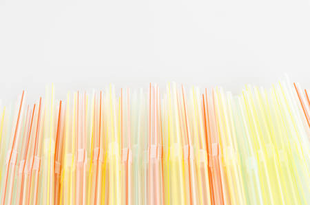 colorful straw on a white  photo
