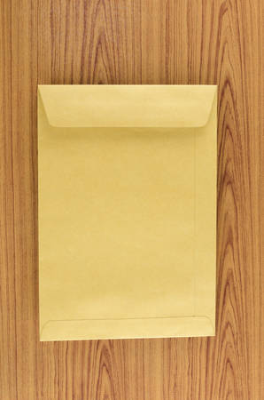 brown envelope on wood table background photo