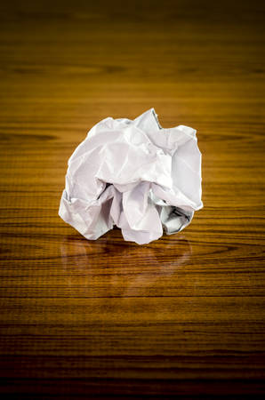 crumpled paper: crumpled paper on wood background Stock Photo