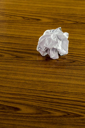creasy: crumpled paper on wood background Stock Photo