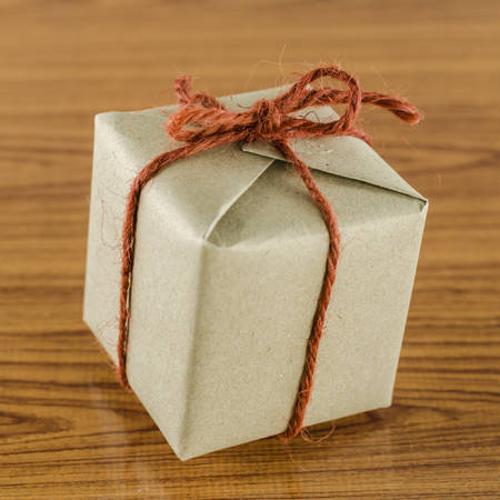 brown gift box on wooden background photo