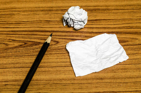 ball lump: paper scrap and crumpled with pencil on wood background