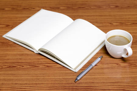 coffee and notebook on wood background concept coffee time photo