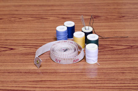 sewing kit on wood background photo