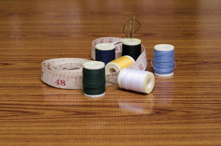 sewing kit on wood background photo