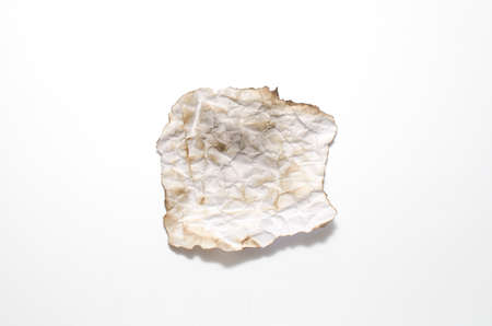 burn of crumpled paper on a white background photo