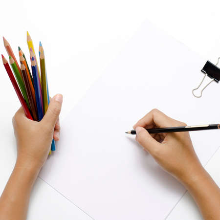 asia woman right hand with black pencil and left hand with colorful pencil on blank white paper over white background photo