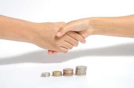 two people shake hand and coin business concept photo