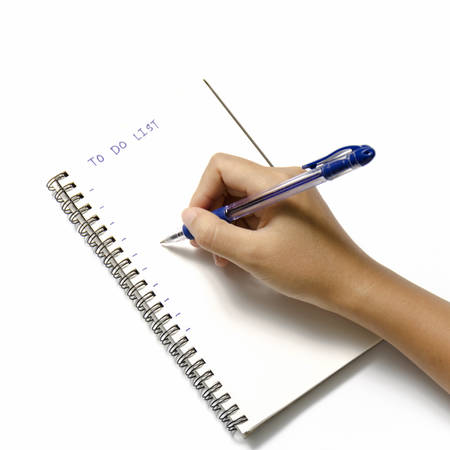 woman hand writing with pen on notebook write to do word over white background photo