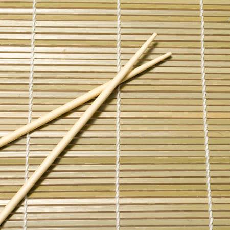 chopsticks on mat photo