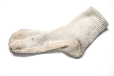 dirty feet: dirty sock on a white background
