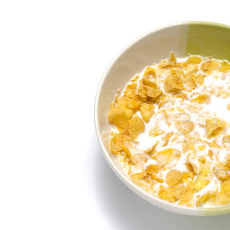 corn flakes in bowl on a white background Stock Photo