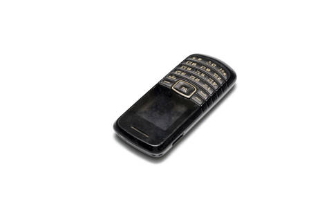 old mobile phone on a white  photo
