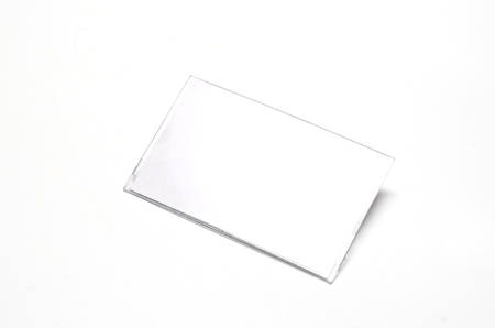 credential: plastic name tag on a white background