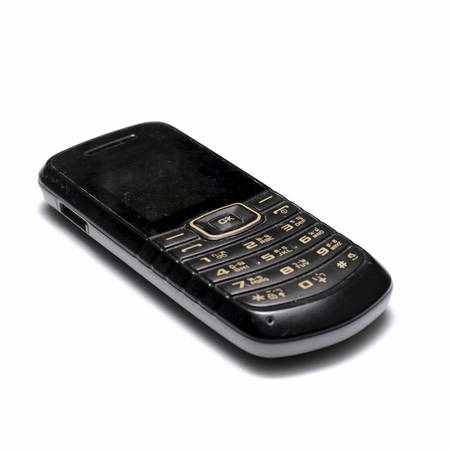 old mobile phone on a white background photo