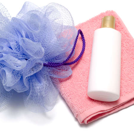 liquid soap: purple bath puff liquid soap and pink towel on a white background